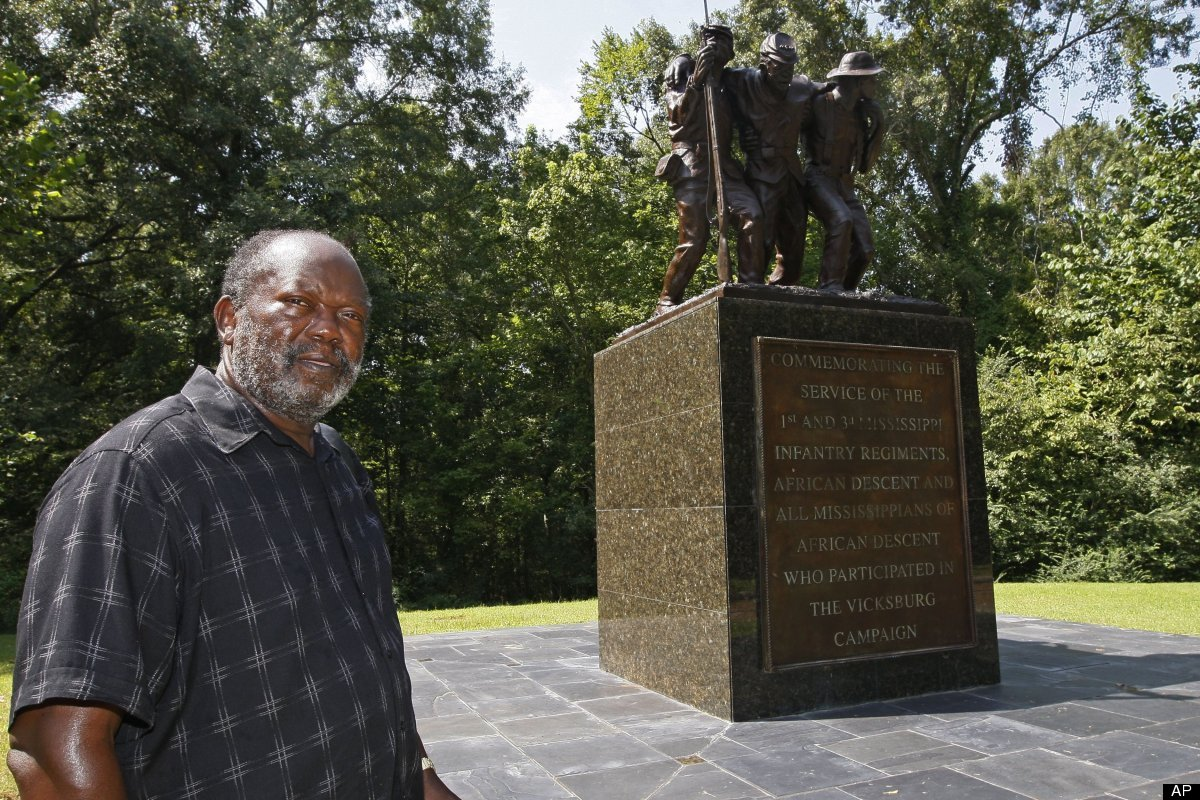 Robert M. Walker, a historian who became Vicksburg's first black mayor in the late 1980s, stands before the first monument wi