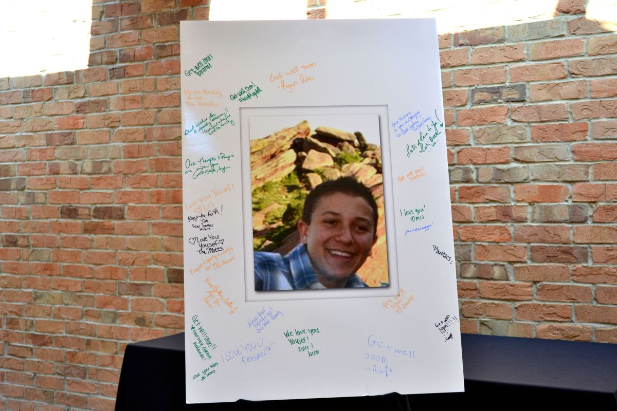 In place of a guestbook, well-wishers and friends signed a picture of Yousef Gharbi outside the room where the fundraiser was