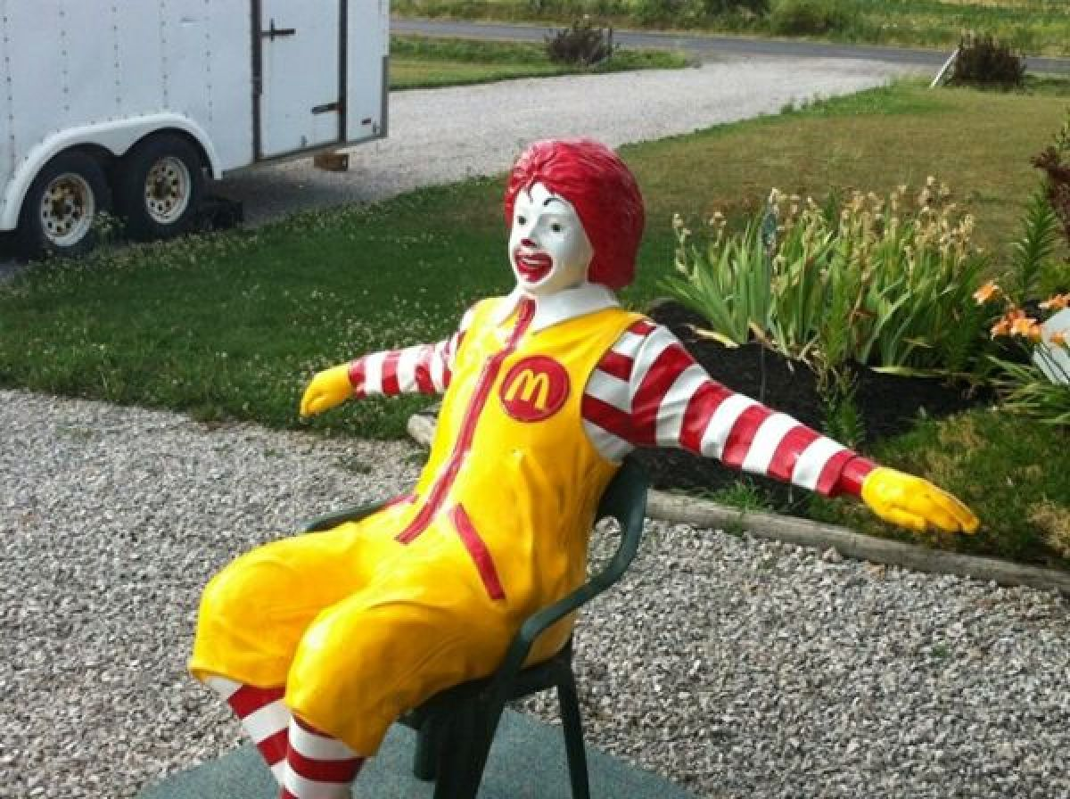 Yep, this is him. The creepy hamburger-slinging clown, with his arms out acting very casual. But we're pretty sure he's got s