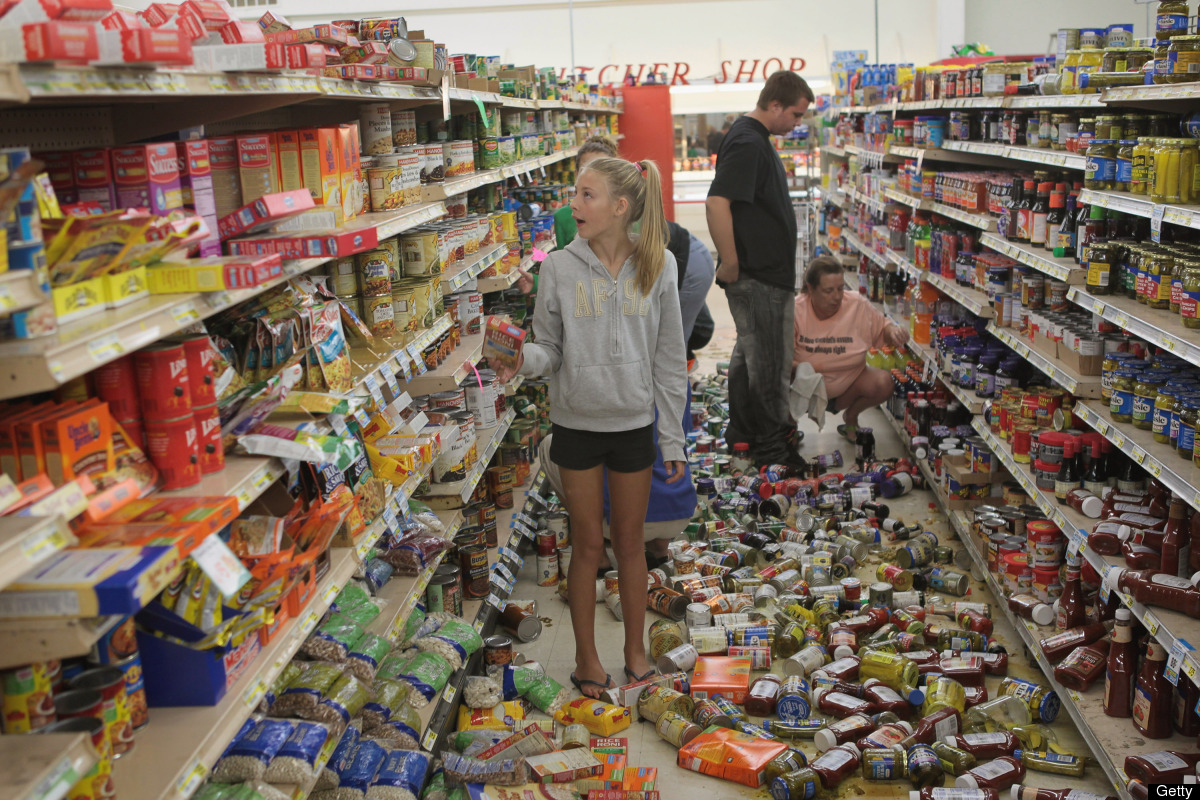 MINERAL, VA - AUGUST 24:  Morgan Nolan (C) joins other volunteers as they help to restock the shelves at Millers Market after