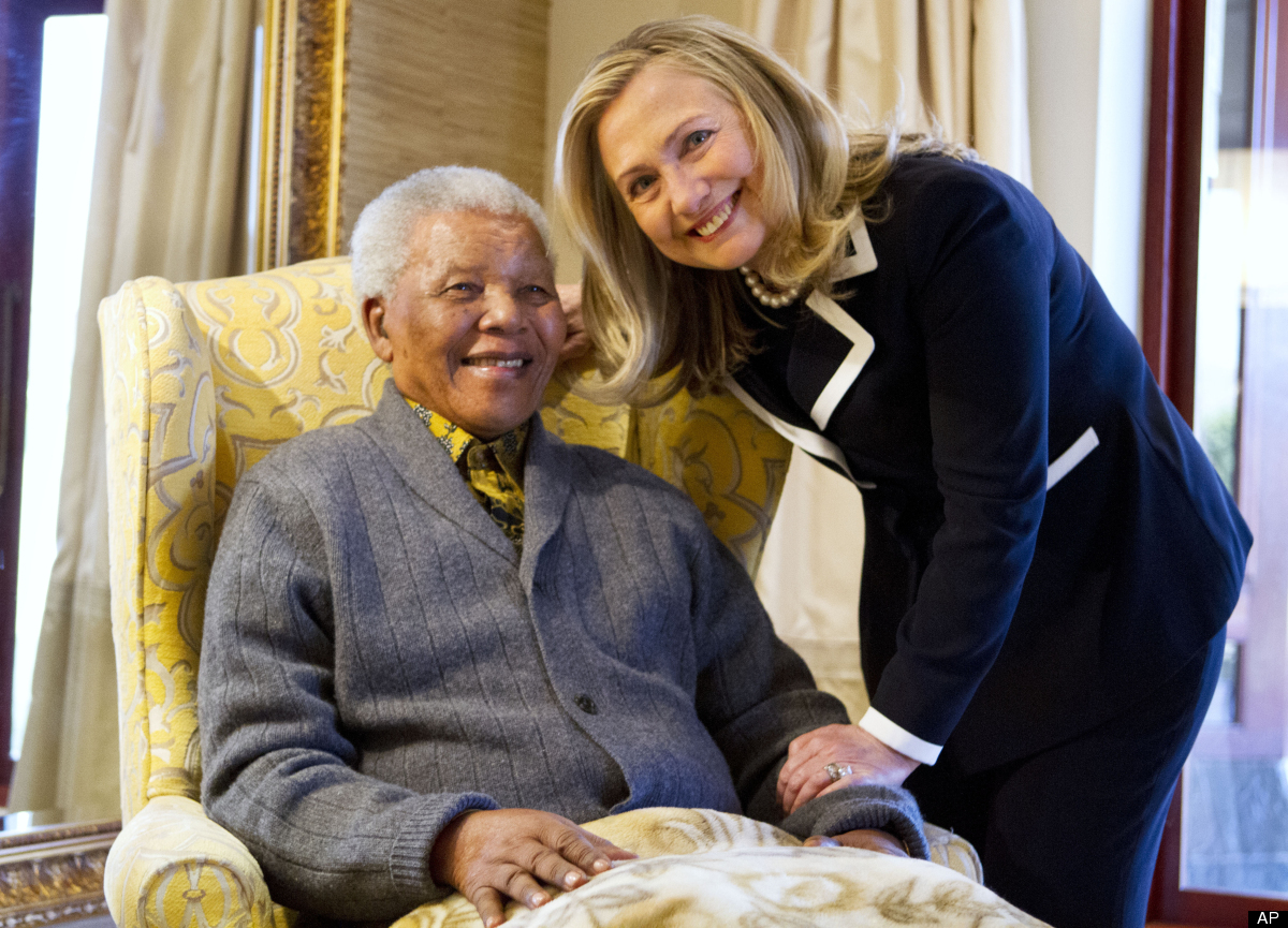 Secretary of State Hillary Rodham Clinton meets with former South Africa President Nelson Mandela, 94, at his home in Qunu, S