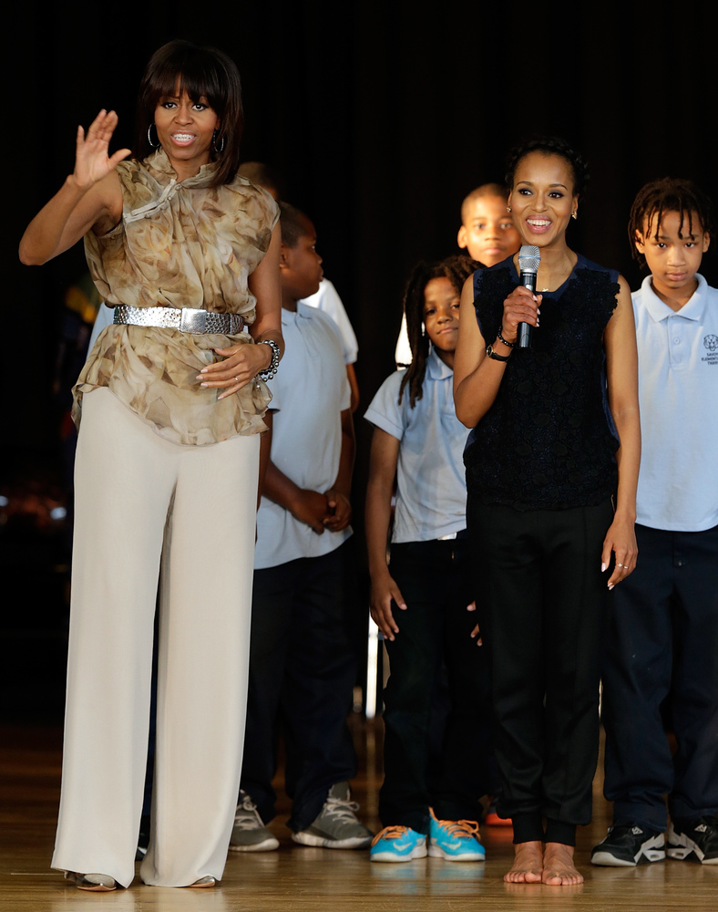 They both visited a D.C. school on May 24, 2013