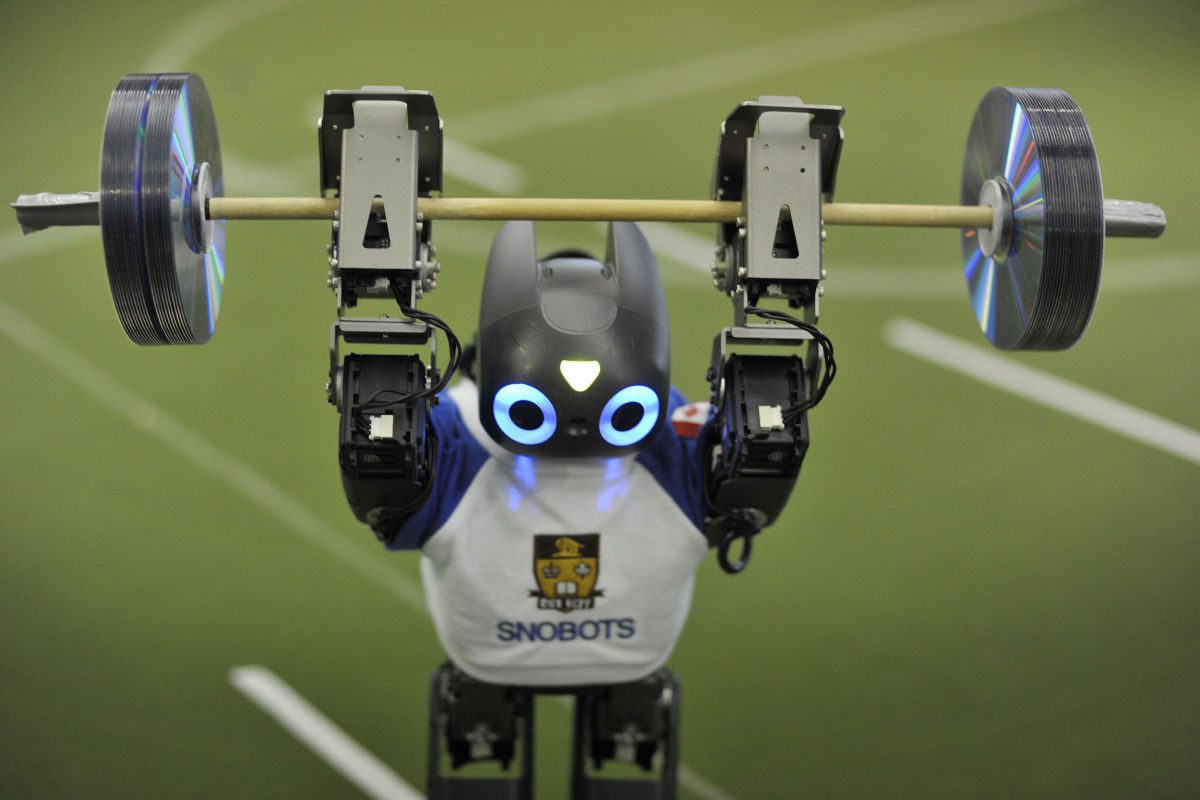 A robot competes in the weightlifting at the FIRA International RoboWorldCup.