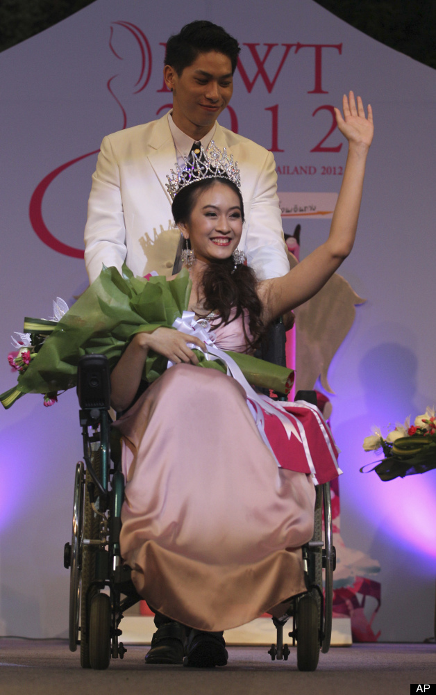New Miss Wheelchair Pattarawan Panicha acknowledges to the audience after winning the Miss Wheelchair Beauty pageant in Bangk