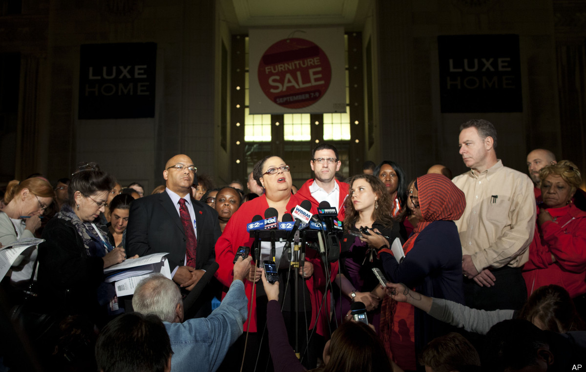 Chicago Teachers Union President Karen Lewis, centre, tells reporters at a news conference outside the union's headquarters t