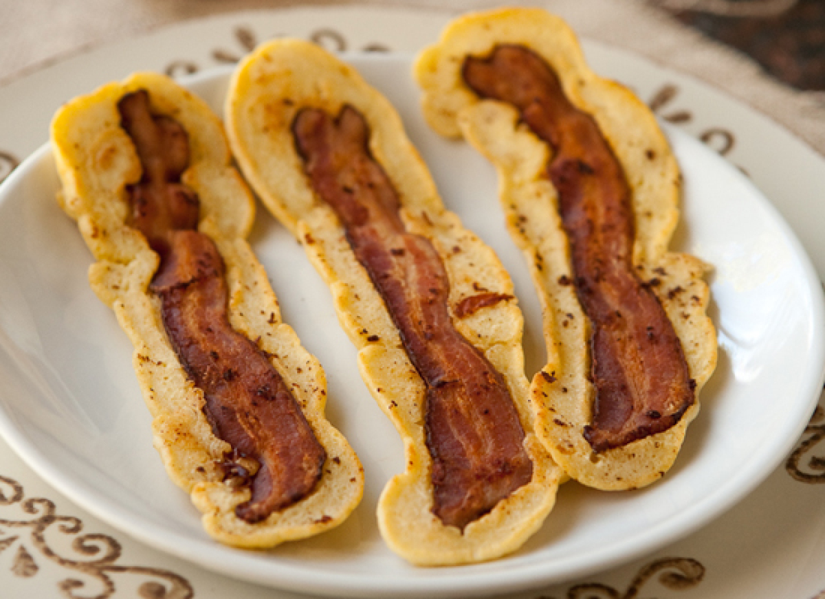"<strong>Get the <a href=""http://eclecticrecipes.com/bacon-strip-pancakes"" target=""_hplink"">Bacon Strip Pancakes recipe from E"