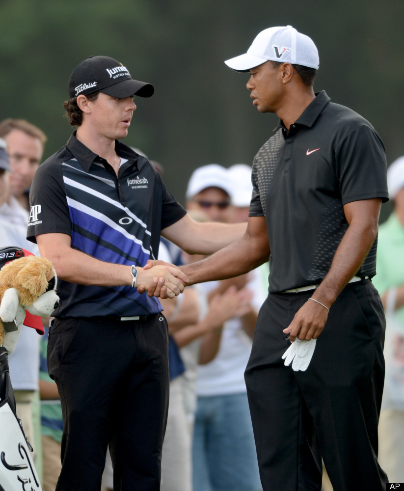 Tiger Woods, right, shakes hands with Rory McIlroy of Northern Ireland before the start of The Barclays golf tournament at Be