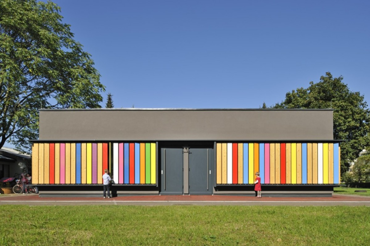 An extension of a typical Slovenian prefab kindergarten from the '80s, the colorful, interactive design is a response to the