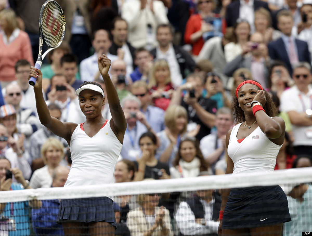 Venus Williams, left, and Serena Williams of the United States celebrate their victory against Andrea Hlavackova and Lucie Hr