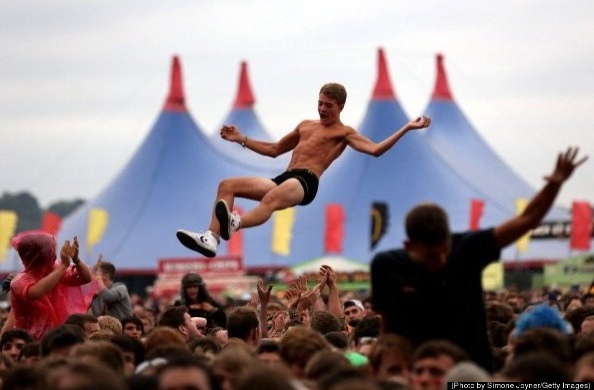 A music fan soaks up the atmosphere as You Me At Six performs live on the Main Stage during Day One of Reading Festival 2012