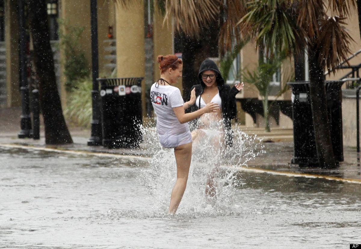 Heather Boss, right, and Brittney Lambert, both of Oklahoma, have fun in a flooded street due to heavy rains in Key West, Fla