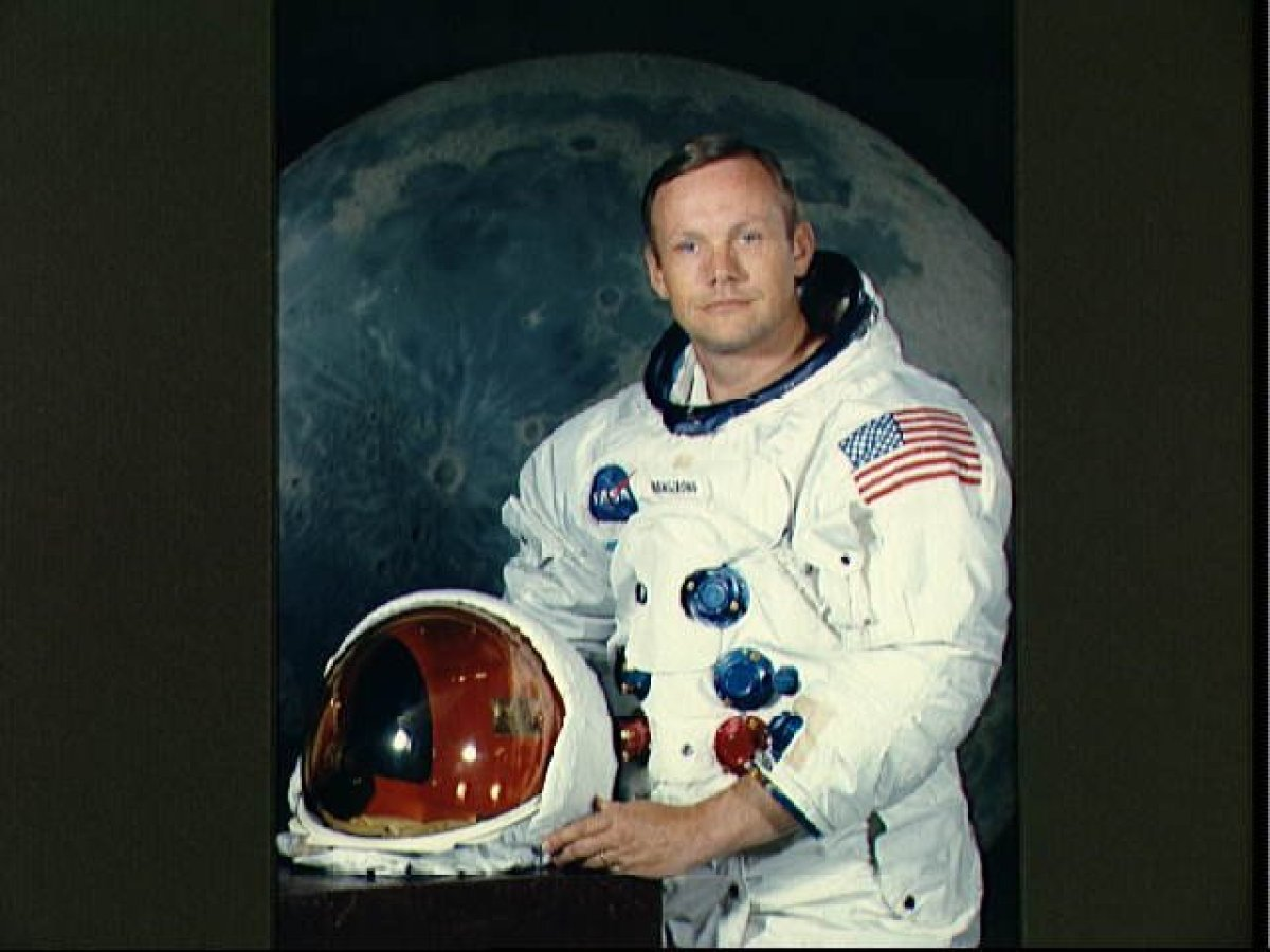 Portrait of Astronaut Neil A. Armstrong, commander of the Apollo 11 Lunar Landing mission in his space suit, with his helmet