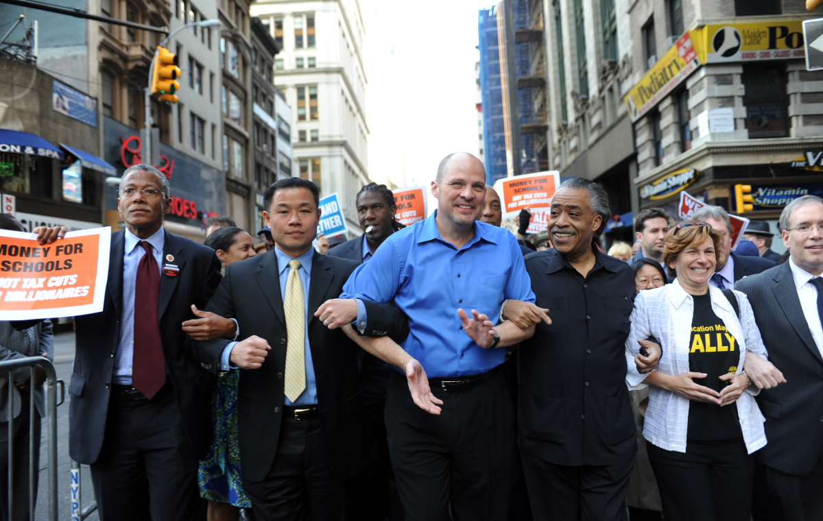 Protesters led by Al Sharpton and UFT President Michael Mulgrew march on New York City Hall on May 12, 2011 to stop impending
