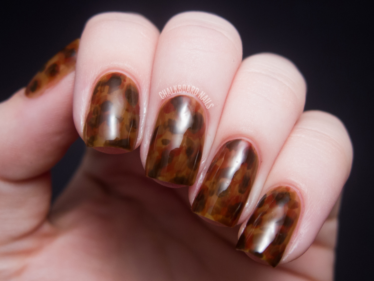 """""""I did these tortoiseshell nails by combining three translucent brown polishes. By layering them in different opacities at di"""