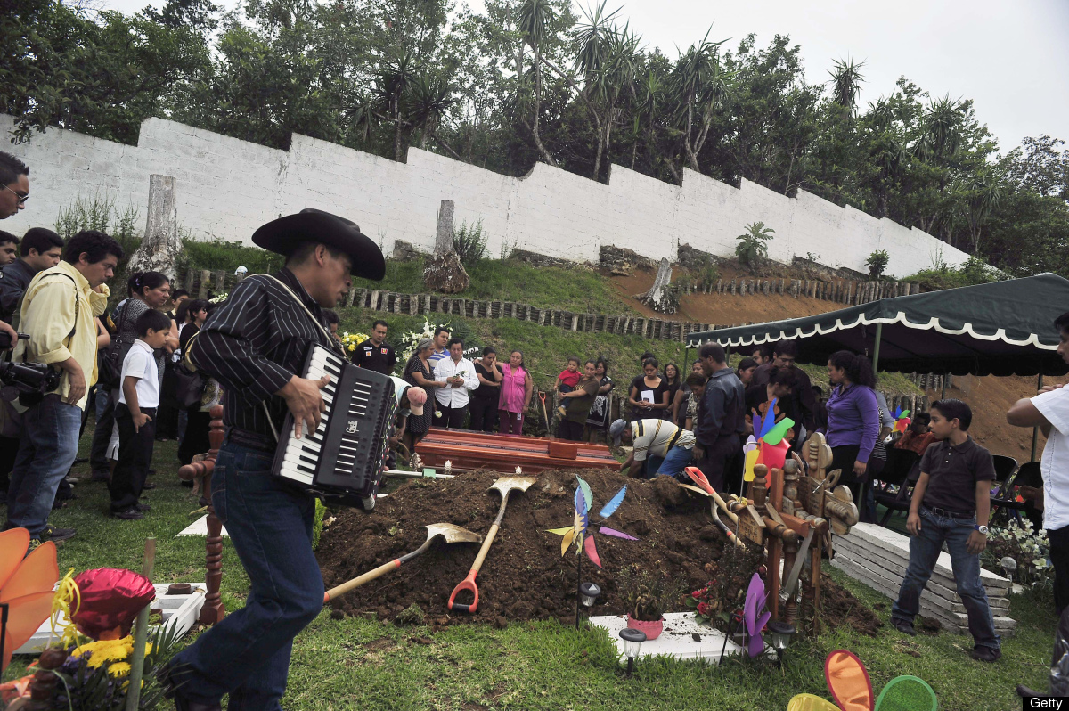 Relatives and friends of Mexican journalist Victor Baez attend his funeral, in Xalapa, Veracruz State, Mexico on June 15, 201