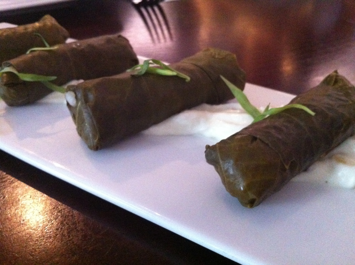 Grape leaves stuffed with butternut squash, rice, pine nuts, tarragon, served with lemon yogurt