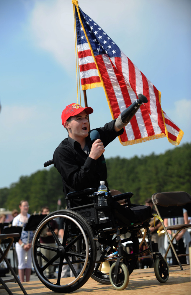 Marine Cpl. Todd Simpson Love, of Acworth, Georgia, who lost both legs and part of an arm fighting in Afghanistan, speaks to