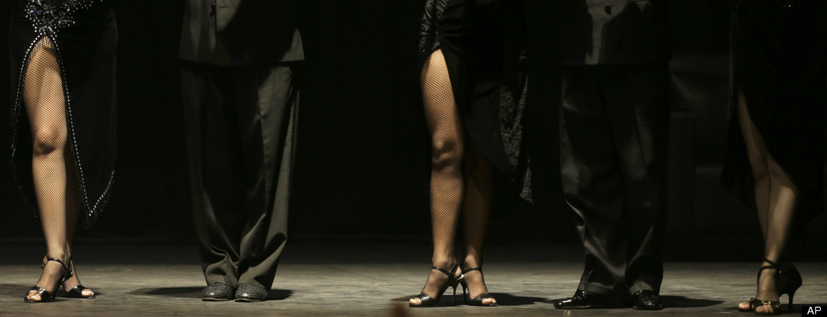 Dancers wait for the final results after competing at the 2012 Tango Dance World Cup stage finals in Buenos Aires, Argentina,