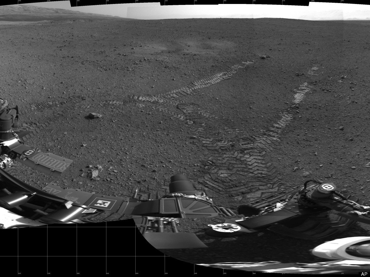 This 360-degree panorama provided by NASA Wednesday Aug. 22, 2012 shows evidence of a successful first test drive for NASA's