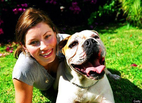 Actress Jessica Biel smiles with her bulldog, East.
