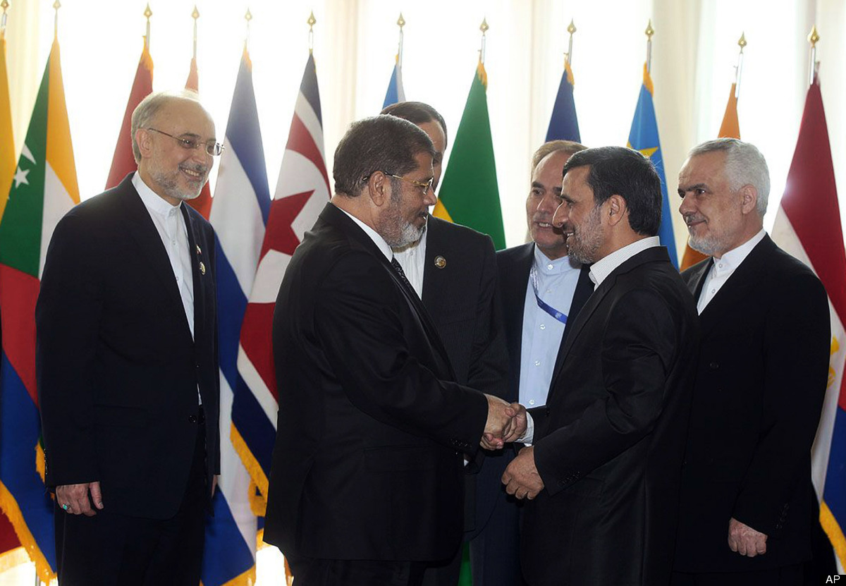 In this photo released by the official website of the Iranian presidency office, Iranian President Mahmoud Ahmadinejad, secon