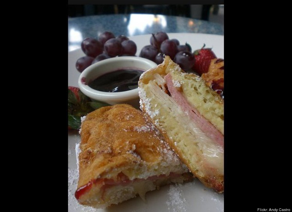 Monte Cristo: mustard, ham and cheese sandwich dipped in egg batter, fried french-toast style and served with powdered sugar