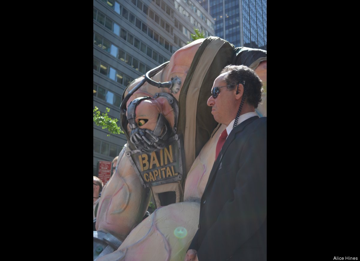 The puppet stands with Elliot Crown, an Occupy Wall Street volunteer playing a security guard.