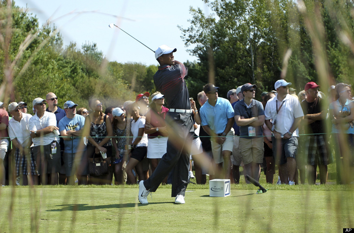 Tiger Woods hits from the third tee during the first round of the Deutsche Bank Championship golf tournament at TPC Boston in