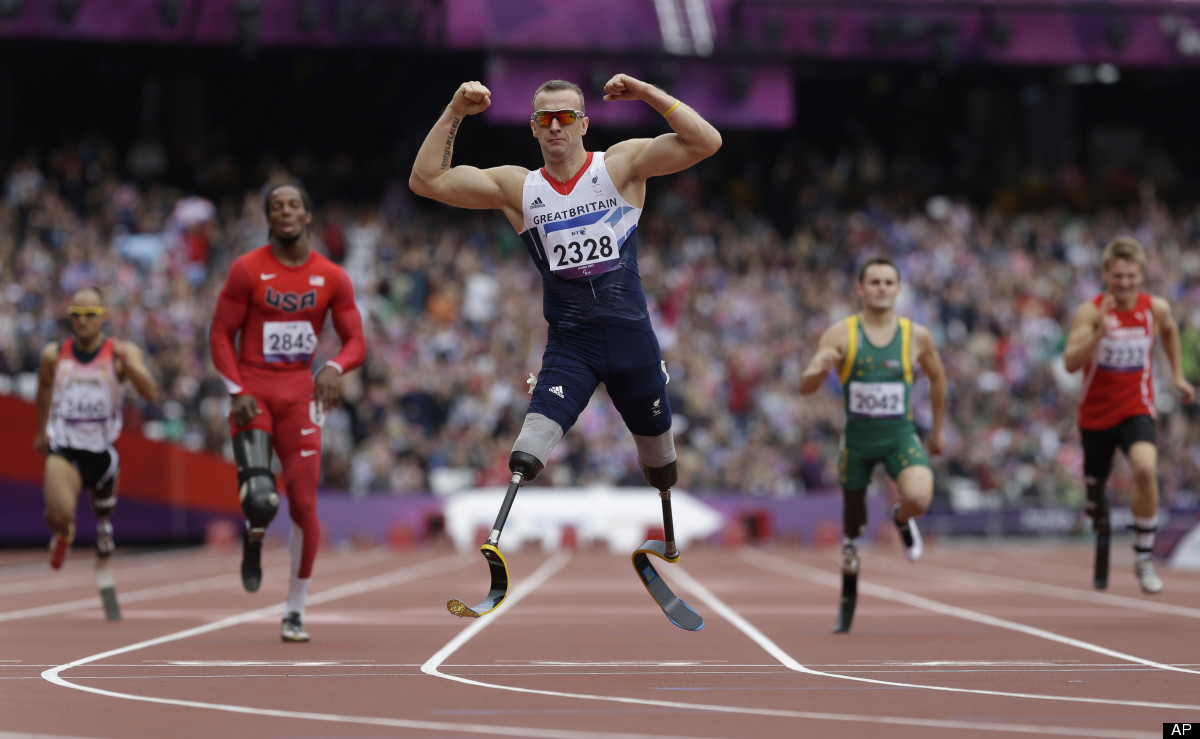 Britain's Richard Whitehead celebrates after winning the men's 200m T42 final race at the 2012 Paralympics in London, Saturda