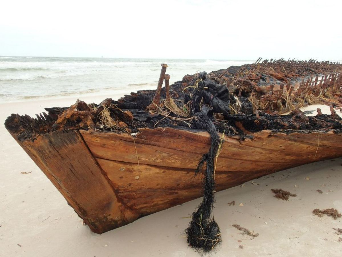 """Photos showing a shipwreck on an Alabama beach uncovered by Hurricane Isaac. <a href=""""https://www.facebook.com/MeyerVacationR"""