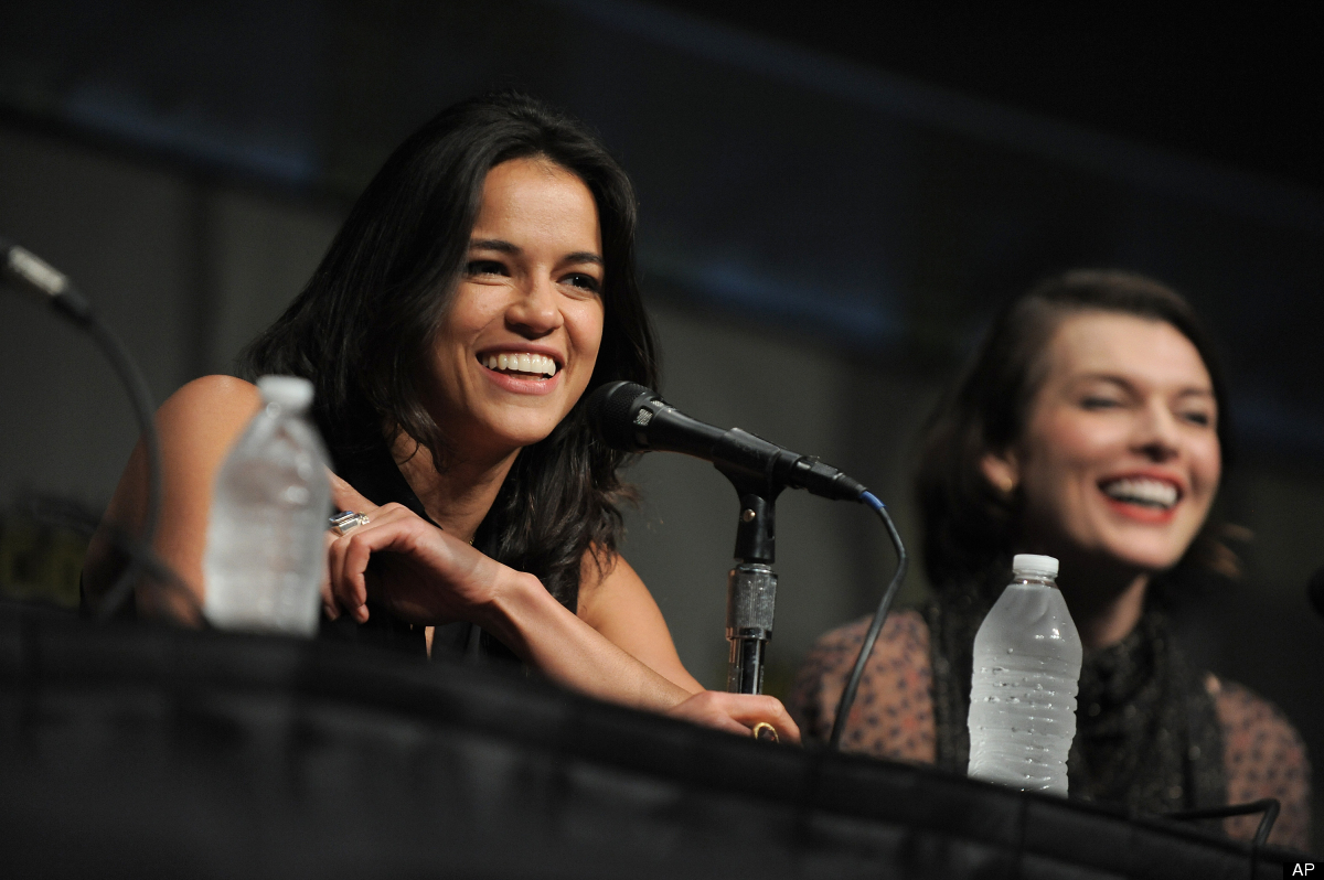 "Michelle Rodriguez and Milla Jovovich attend the ""Resident Evil: Retribution"" panel at Comic-Con on Friday, July 13, 2012 in"