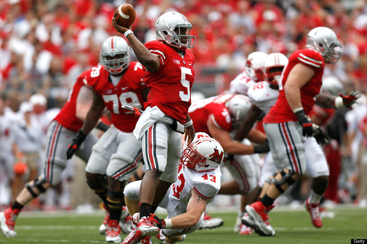 Kent Kern #43 of the Miami Redhawks hits Braxton Miller #5 of the Ohio State Buckeyes as he throws the ball downfield during
