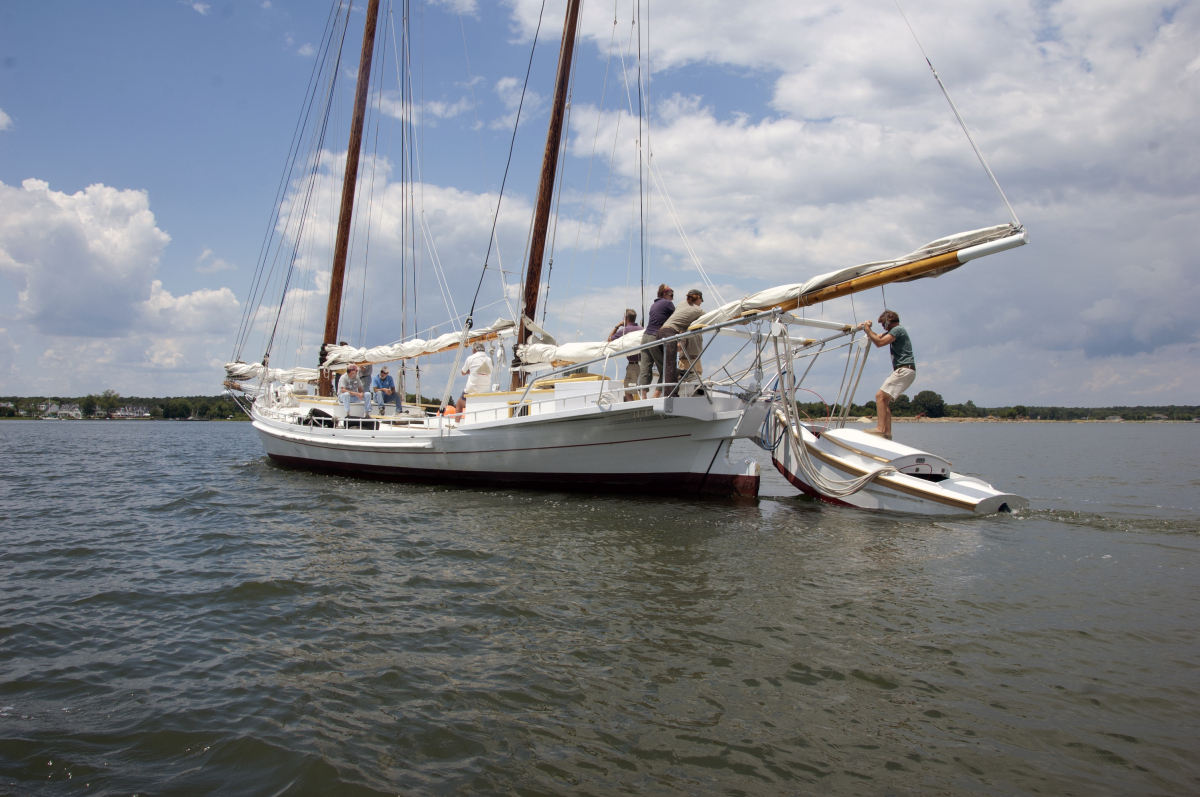The boatyard crew of the Chesapeake Bay Maritime Museum takes the 1889 nine-log bugeye and National Historic Landmark, the <e