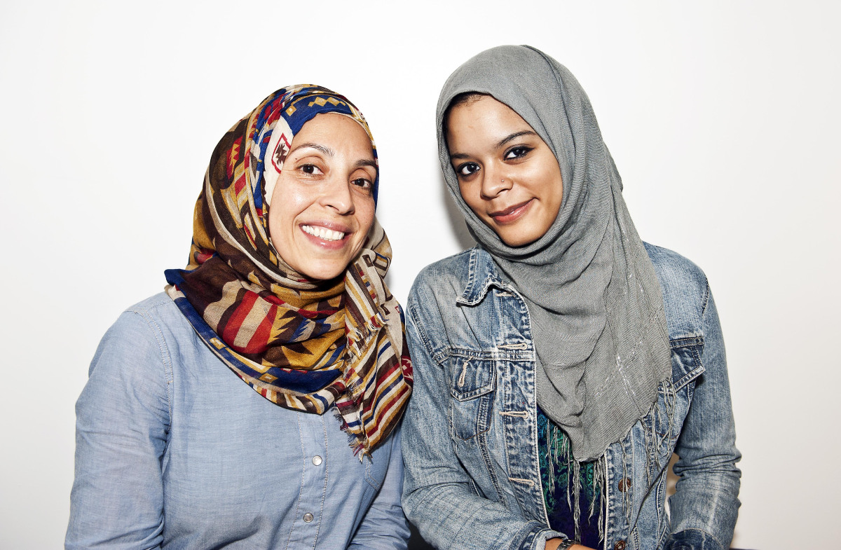 Delma Oliveras, also known by her Muslim name Zainab Ismail and Kalene Santana both Latinas pose for a portrait at the AOL Hu