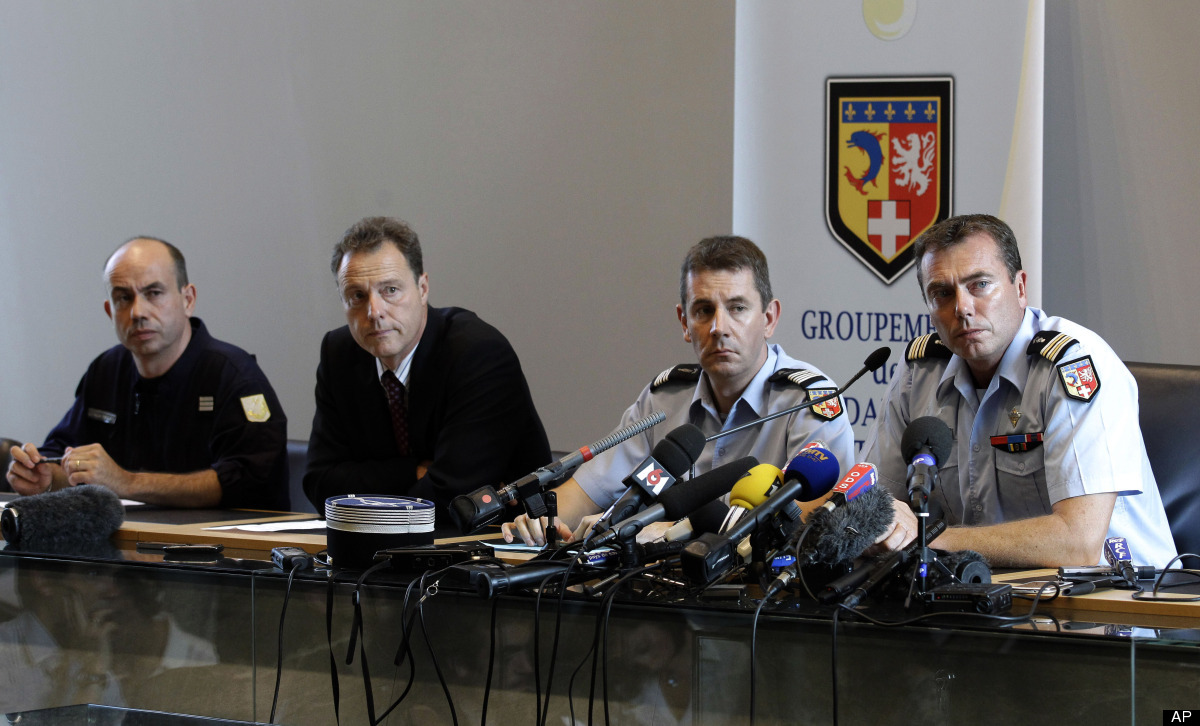 Crime coordinator Capt. Laurent Dourel, left, Annecy prosecutor Eric Maillaud, second left, and French Gendarmes Col. Bertran