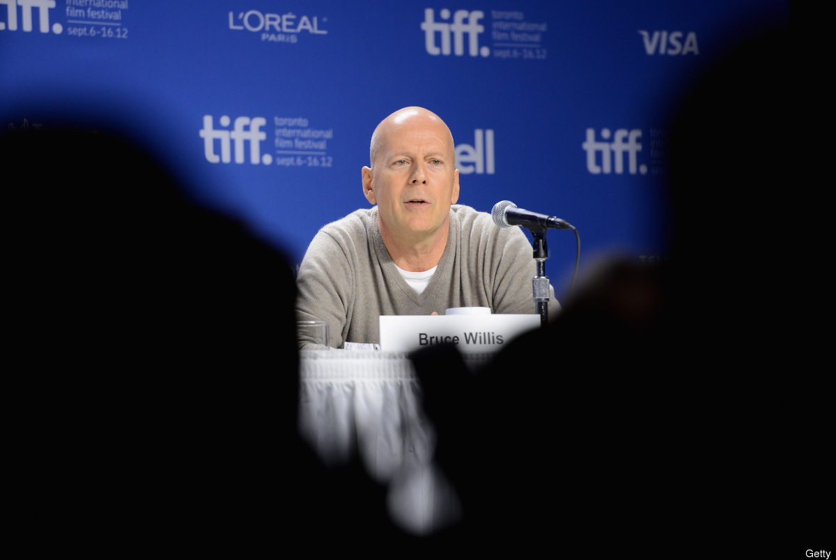 TORONTO, ON - SEPTEMBER 06:  Actor Bruce Willis speaks onstage at the 'Looper' press conference during the 2012 Toronto Inter