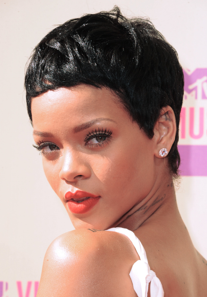 The Barbadian beauty stole the show with her jet black pixie and matte red lips. Photo: Getty Images