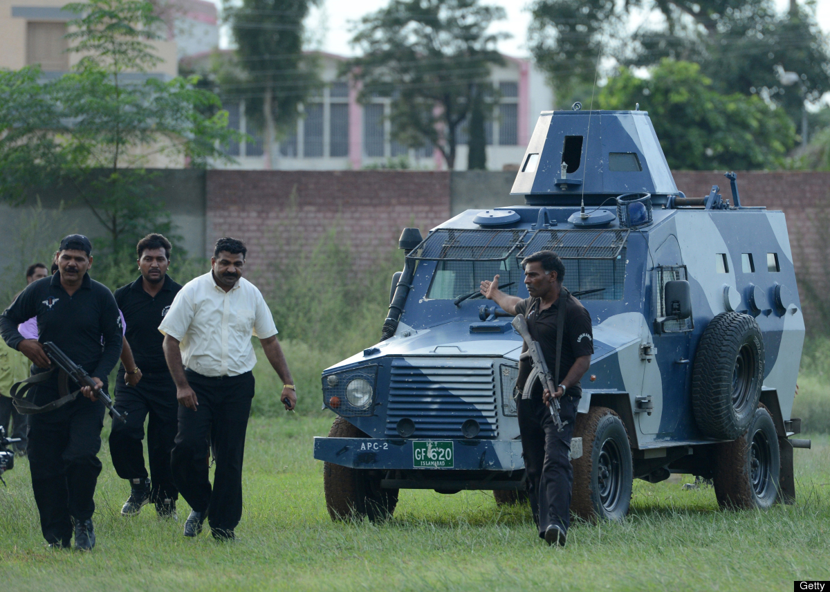 Pakistani police commandos escort a vehicle carrying Rimsha Masih, a Christian girl accused of blasphemy, after her release f