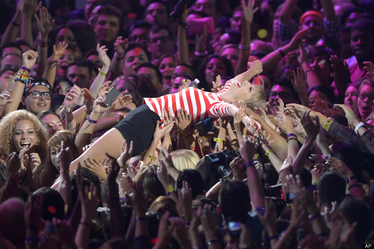 Taylor Swift surfs the crowd at the MTV Video Music Awards on Thursday, Sept. 6, 2012, in Los Angeles. (Photo by Mark J. Terr