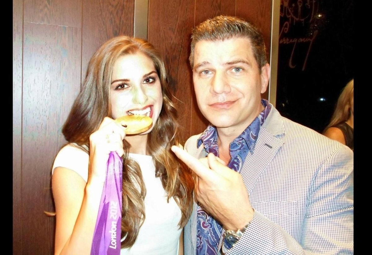 Alex Morgan proves her medal is only plated with Tom Murro at the Girard-Perregaux Wristwatch store on Madison Avenue during