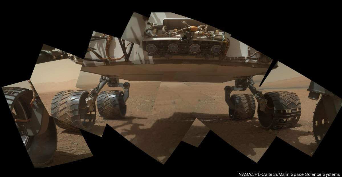 This view of the lower front and underbelly areas of NASA's Mars rover Curiosity combines nine images taken by the rover's Ma