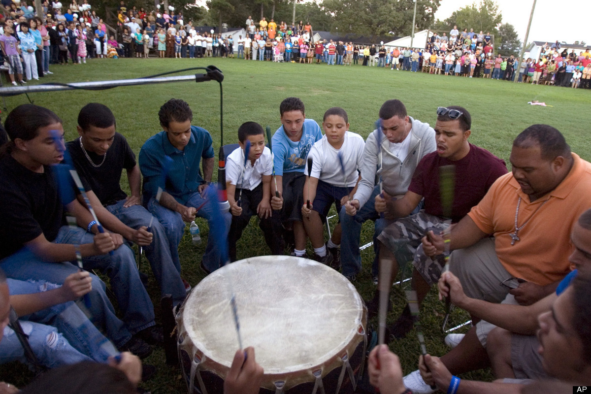 Members of the Stoney Creek drum group and the community sing and play music during a candlelight vigil for Faith Hedgepeth a