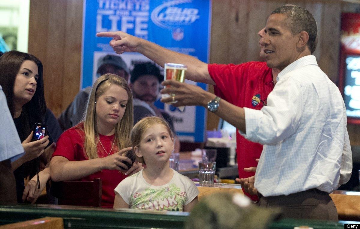 President Barack Obama holds a beer during a visit to Gator's Dockside restaurant in Orlando, Florida, on September 8, 2012 d
