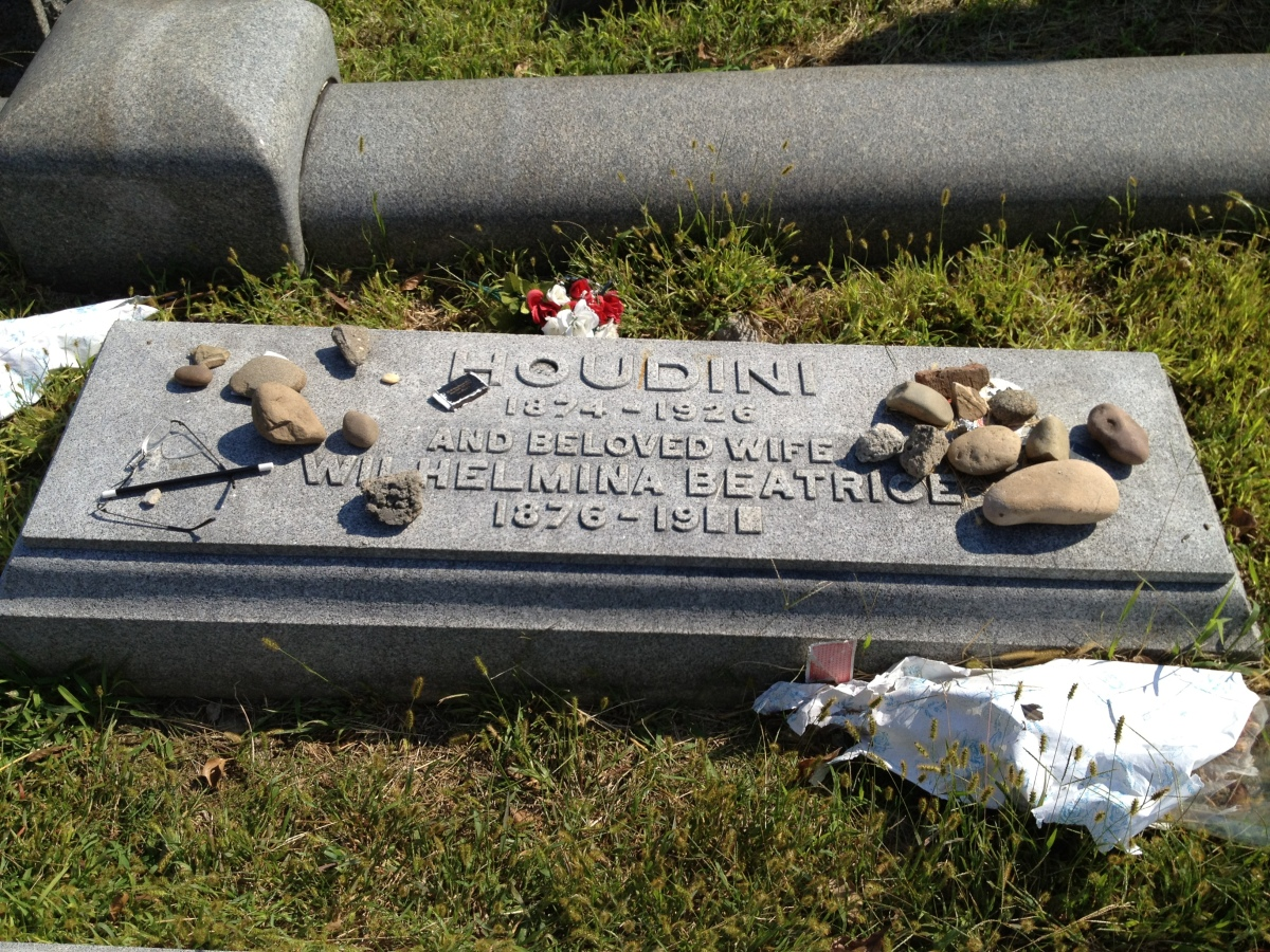 Visitors often leave playing cards, magician's wands, stones and flowers on top of Houdini's grave. He was buried in Machpela