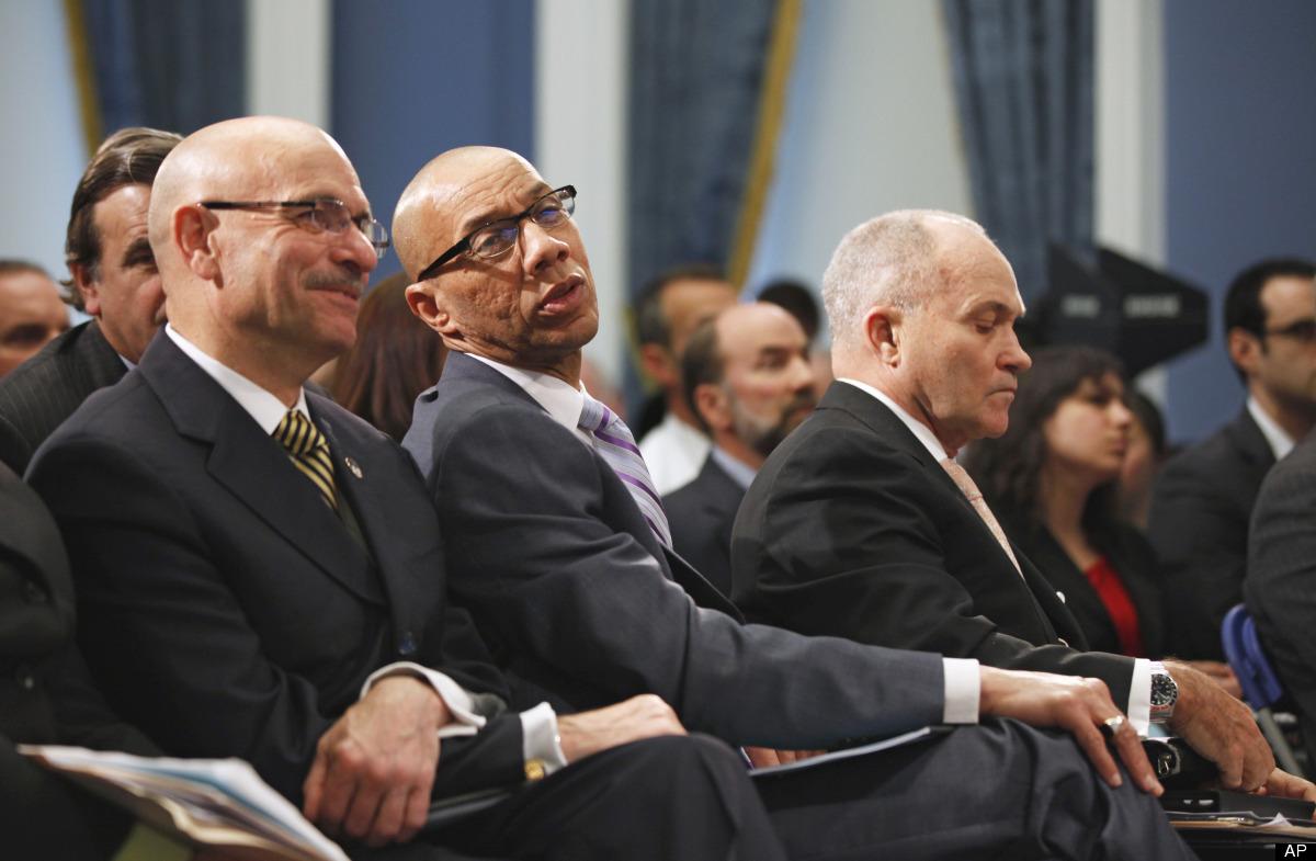 New York City Fire Commissioner Salvatore Cassano, left, sits with New York City Schools Chancellor Dennis M. Walcott, center