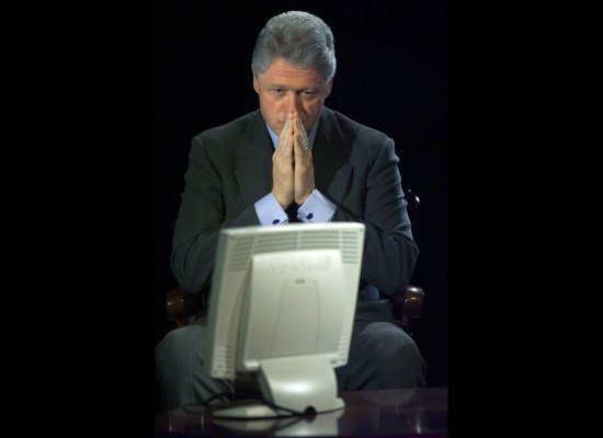 This may be the old-school version of Obama's Twitter Town Hall: Bill Clinton looks at questions during a Democratic Leadersh