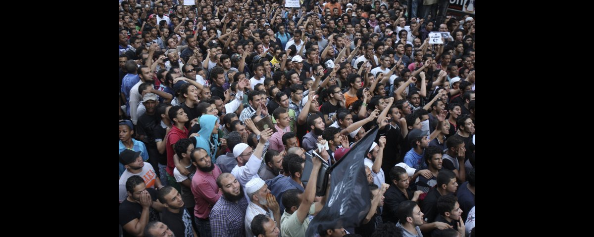 Protesters chant slogans outside the U.S. embassy in Cairo, Egypt, Tuesday, Sept. 11, 2012. Egyptian protesters, largely ultr