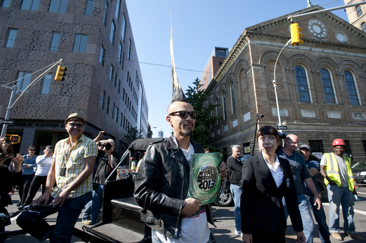 Japanese fashion designer and Guinness World record holder of the largest Mohawk, Kazuhiro Watanabe shows off his Mohawk at W