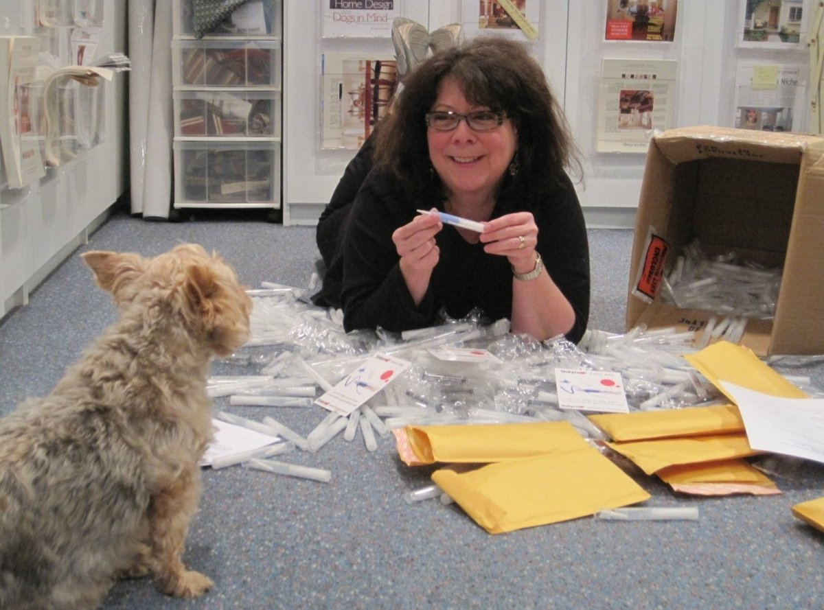 Debbie in the office, in September of 2012, consulting with her trusted advisor, Daisy.