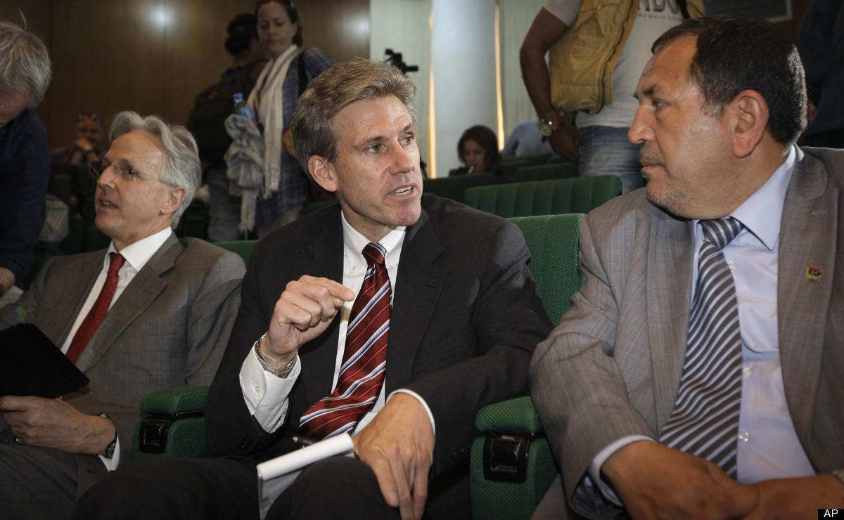 In this photo taken Monday, April 11, 2011, then U.S. envoy Chris Stevens, center, accompanied by British envoy Christopher P